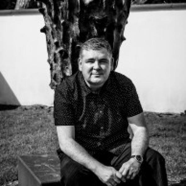 Darren Shan sitting outside