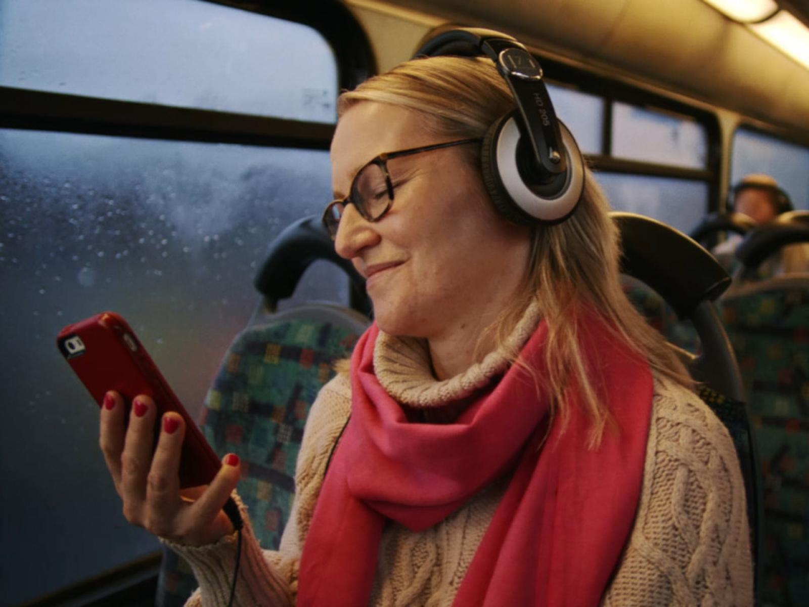 Woman using Online Services on Bus